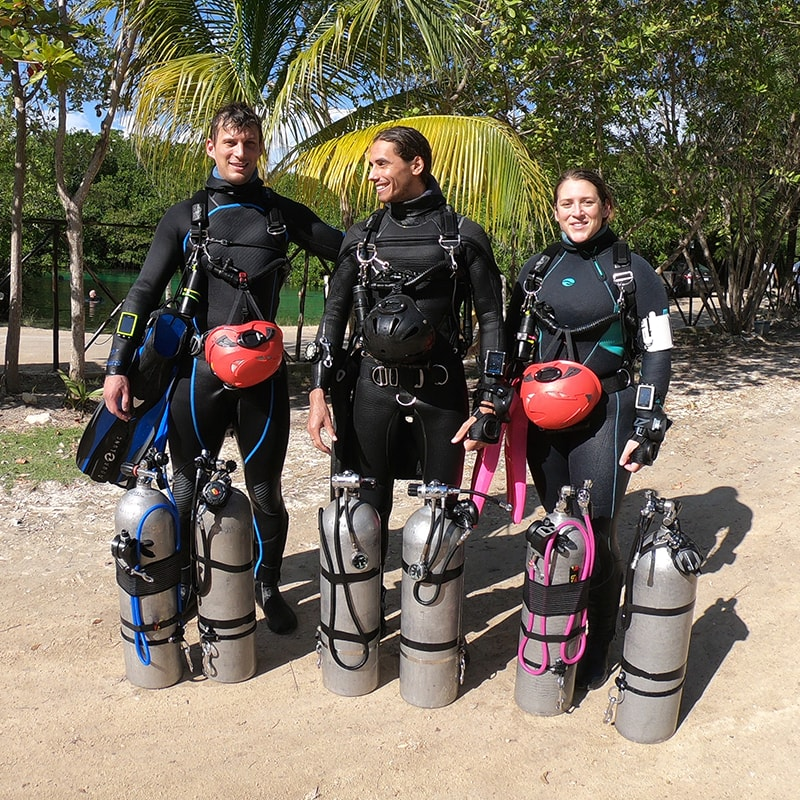 sidemount divers taking a cave training in a cenote in playa del carmen mexico